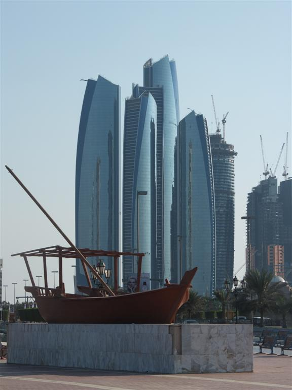 Boat monument at marina with Emirates Towers
