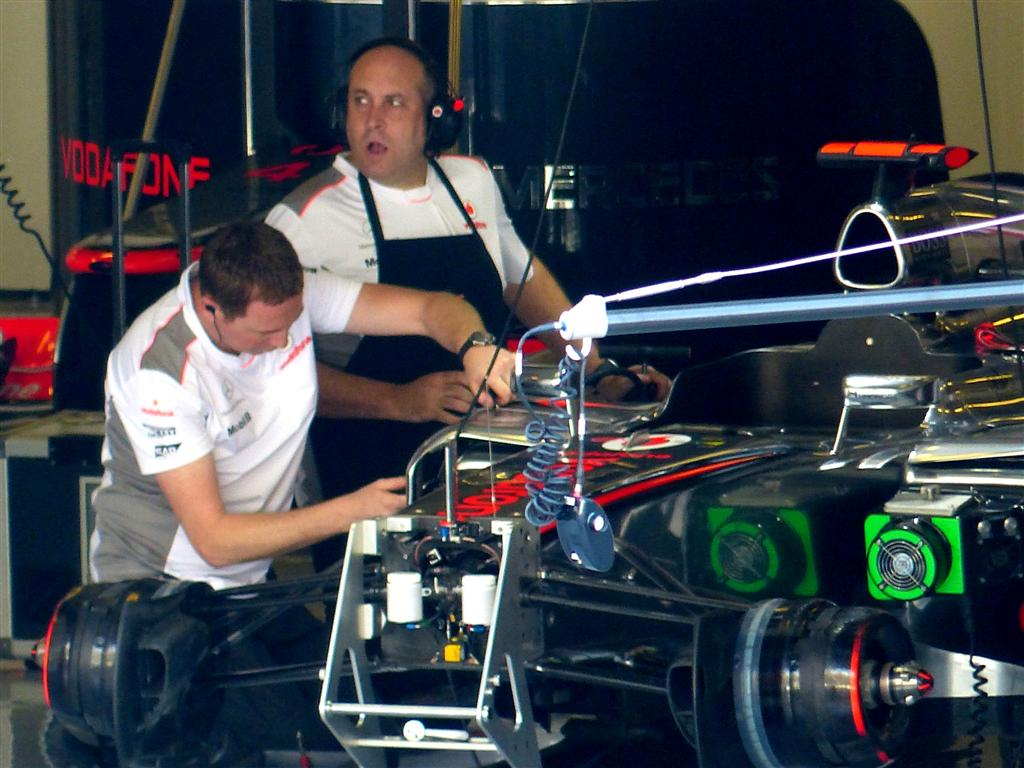 Mechanics working on Hamilton's McLaren