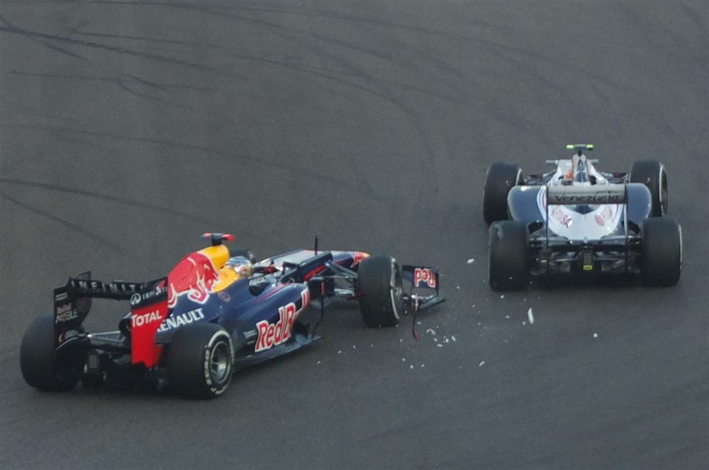 Sebastian Vettel and Bruno Senna clash at turn 8