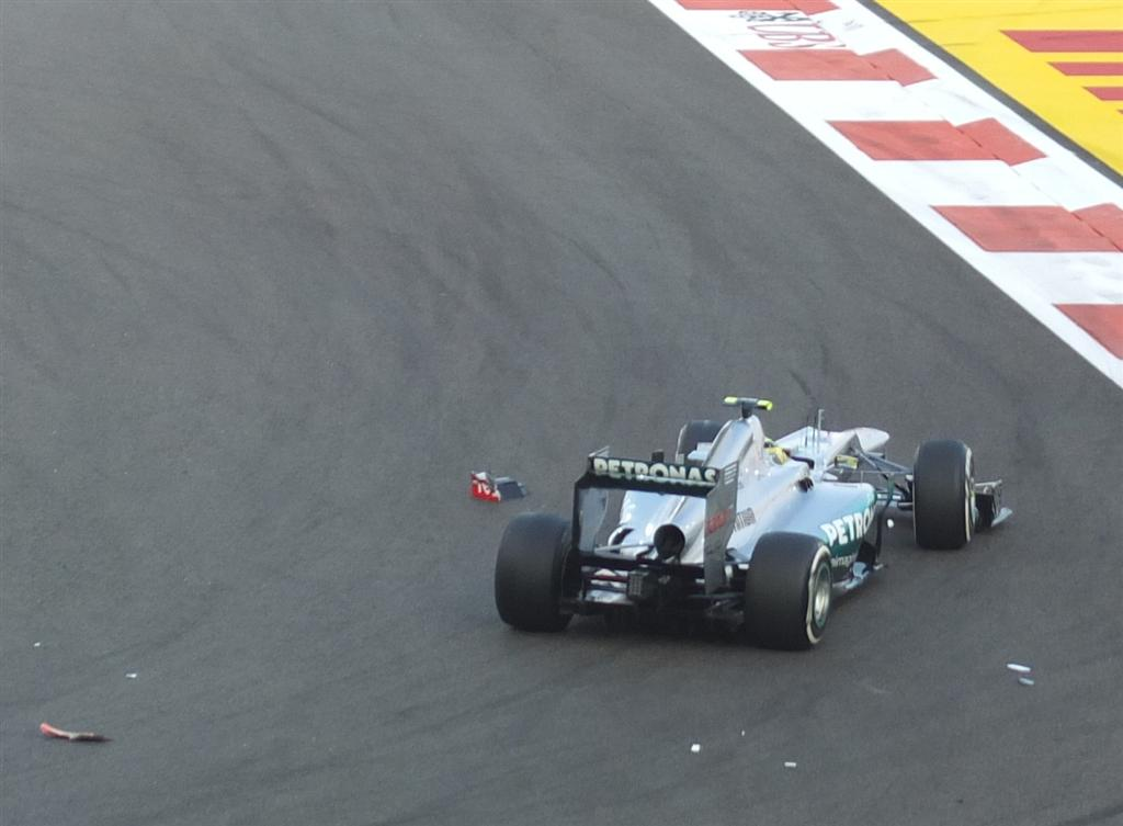 Nico Rosberg picks his way through debris on turn 8